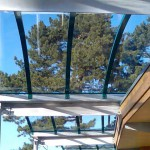 They weren't all pitched roofs, or multiwall.  This roof has cold curved solid polycarbonate