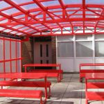 Bright and cheerful school outside eating area