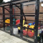 Lockable doors provide a safe place to store these nursery toys