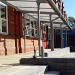 Opal multiwall polycarbonate & Twinfix aluminium rainwater goods in this school canopy