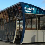 6mm bronze solid polycarbonate, with the roof and front cold curved during installation