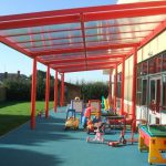 A free-standing school canopy fitted with a multiwall polycarbonate roof