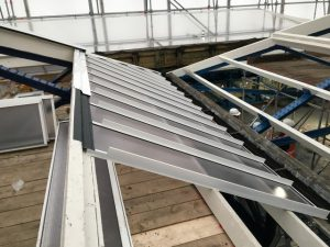 Watertight flashing between tiers one and two